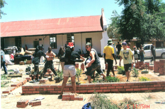 Members of the Rivers Foundation Church in Sandton - building plant boxes and planting flowers and trees in the centre's courtyard.